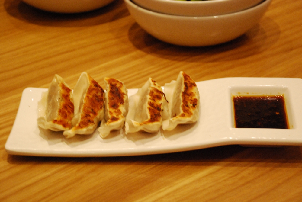 ChickenyGyoza served with a chili garlic, sesame and soy sauce.