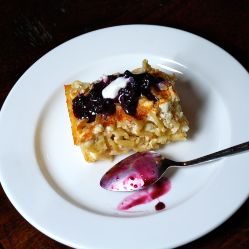 Noodle Kugel with blueberry sour cream sauce.