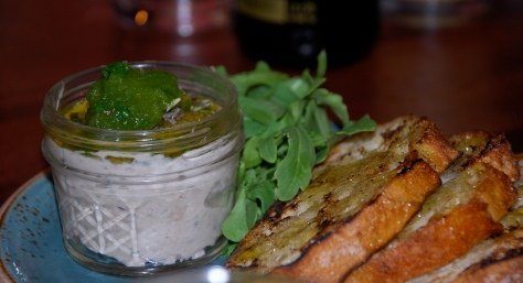 This is a side dish of smoked fish pâté and toast.  The arugula is perfect on top.  You might think you don't like fish pâté but try it, it's so good.