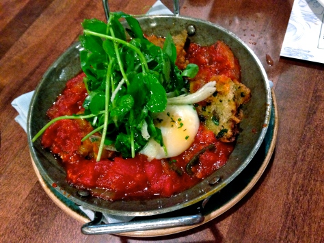This shakshouka is topped with pea greens, spiced with harissa and has nice, briny anchovy croutons rounding out the flavours.