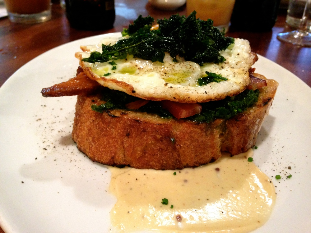 Kale Toasts with anchovy aioli and Benton's bacon for brunch at Alden & Harlow.