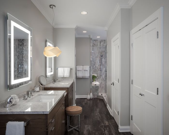 "This design from Beckwith Interiors shows both a ""show piece"" light fixture and then some functional recessed lights. Designer: Samantha Culbreath Photographer: Chip Pankey"