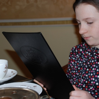 Isabelle perusing the menu. I forgot to mention there are also tea sandwiches for children (and adults I suppose) with more childlike tastes which include peanut butter and jelly tea sandwiches, chocolate chip cookies, chocolate covered strawberries and pots of hot chocolate.