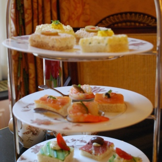 Tea sandwiches. In the middle is the shrimp (not a sandwich) and the smoked salmon sandwich.