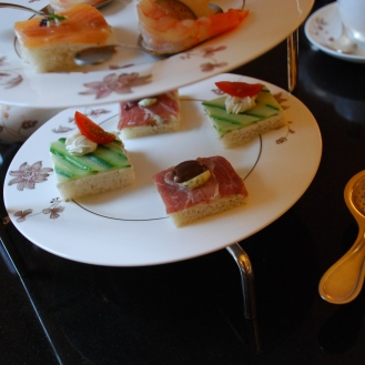 Cucumber tea sandwich and prosciutto tea sandwich.