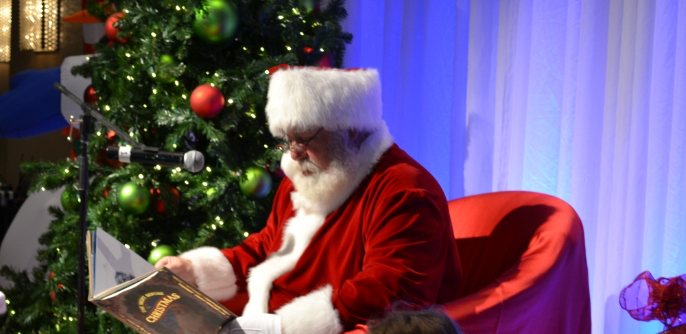 Santa reading at the Royal Sonesta Santa breakfast.  Photo courtesy of the Royal Sonesta Boston