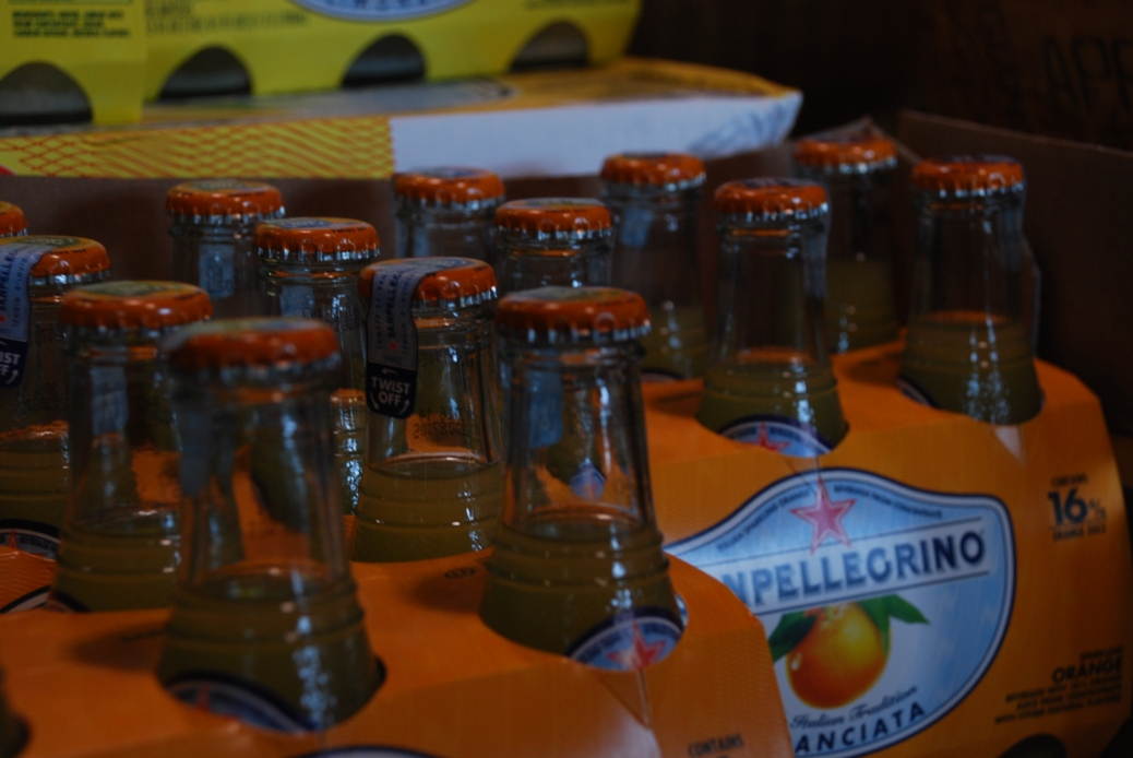 You can find San Pellegrino's Aranciata at most grocery stores (at least in and around Boston). You can find the really cute ones in a bottle at Tuscan Market (pictured here) or at specialty stores.