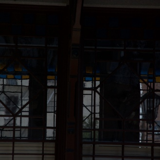 The windows at the train depot are beautiful. The building has a grace that takes you back in time to a different era.