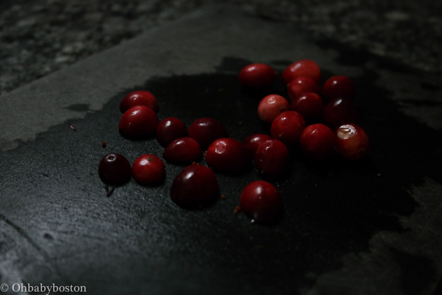 Halving the cranberries will help you keep all your fingers as they will not roll as you mince them.