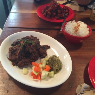 """The Rendang is cooked with """"too many spices to list"""" and instead of a muddy somewhat familiar mix of spices on beef you taste something completely new and different."""