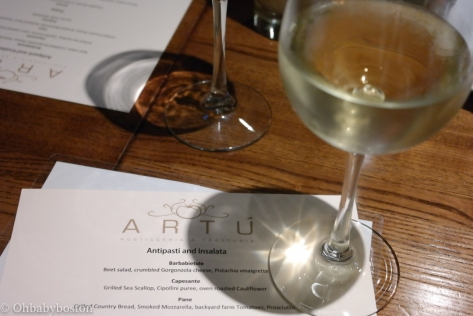 A glass of white at Artú in Boston's North End.