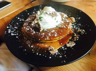 Lincoln Tavern Test Kitchen Brunch's Butternut Squash pancakes with all kinds of deliciousness on top (toffee caramel sauce, nuts, cream)