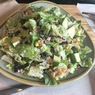 The salad is massive at Maynard's The Brook. It has a kick to it too.