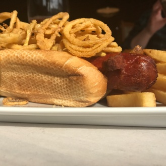 You have to have this once. A hot dog wrapped in bacon and topped with onion rings. Get it to share though because a bite or two is plenty, but well worth it.